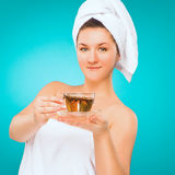 Girl with tea and a towel. Stock Image