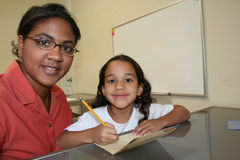 Girl and Teacher Royalty Free Stock Image