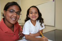 Girl and Teacher Stock Photo