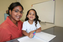 Girl and Teacher Stock Image