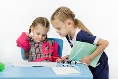 Girl teacher checks written by a disciple Stock Photography