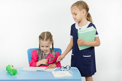Girl teacher found a mistake in the student notebooks Royalty Free Stock Photography