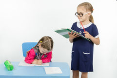 Girl teacher reading assignment student Royalty Free Stock Images