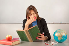 Girl teacher reading book Royalty Free Stock Images