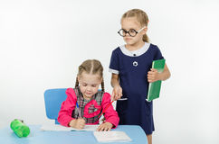 Girl teacher supervises the job apprentice Royalty Free Stock Photography