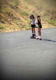 Girl Teaching Friend to Roller Skate Royalty Free Stock Photo