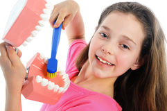 Girl teaching how to brush teeth Stock Image