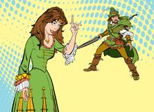 Girl teaching a man. Teaching princess. Lady in medieval dress. Medieval legend. Medieval woman. Robin Hood. Lady in medieval dress. Girl laughs at a man Royalty Free Stock Photography
