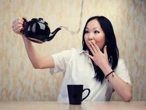 Girl and teapot Royalty Free Stock Photos