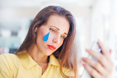 Girl with tear. Sad smiley concept. Woman with emoji tear stock images