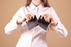 Girl tearing a piece of paper in half blank white flyer brochure Stock Photography
