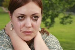 Girl in tears. A girl in tears. Facial emotions of a young woman Royalty Free Stock Photos