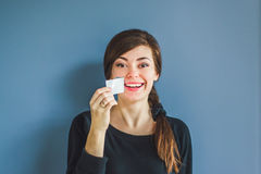 Girl tears off an adhesive tape from a mouth Royalty Free Stock Images