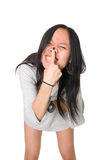 Girl is teased, presses a finger nose Royalty Free Stock Photography