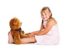 Girl with teddy-bear. Isolated on white background Royalty Free Stock Image