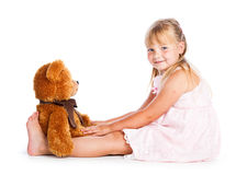 Girl with teddy-bear. Isolated on white background Stock Photo
