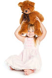 Girl with teddy-bear. Isolated on white background Royalty Free Stock Images