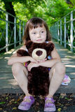 Girl with teddy bear Royalty Free Stock Photography