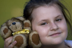 Girl and teddy bear. Clouse up portrate of young girl with teddy bear Stock Photos