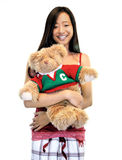 Girl With A Teddy Bear. Girl standing with a teddy bear on a white background Royalty Free Stock Photos
