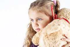 Girl with teddy bear Stock Images