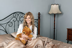 The girl with a teddy bear Royalty Free Stock Photo