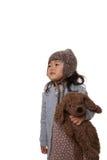 Girl and teddy bear. A girl holding her teddy bear stock photography
