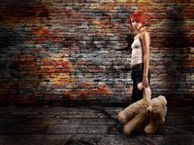The girl with a teddy bear Stock Images