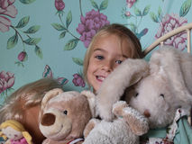 Girl with teddy bear. Little girl with her teddy-bears on her bedroom Stock Photo