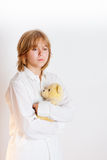 Girl with teddy bear. Girl in white looking with teddy bear overwhite Stock Image