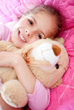 Girl with a teddy bear Stock Photography