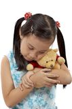 Girl with a teddy bear Royalty Free Stock Images