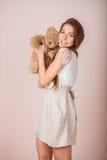 Girl and teddy bear Royalty Free Stock Photo