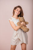 Girl and teddy bear Royalty Free Stock Image