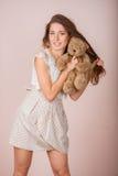 Girl and teddy bear Stock Image