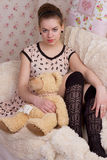 Girl with teddy bear in bed Stock Photo