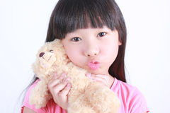 Girl with Teddy-bear in an embrace Stock Image