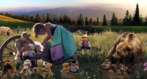 Girl with teddy bear in field with bears