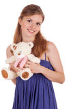 Girl with teddy bear in hands Royalty Free Stock Images