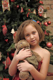 Girl with teddy bear in her hands Stock Images