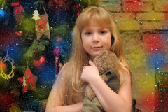 Girl with teddy bear in her hands Royalty Free Stock Images