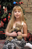 Girl with teddy bear in her hands Royalty Free Stock Image