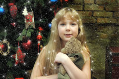 Girl with teddy bear in her hands Stock Photo