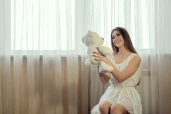 Girl with teddy bear for lifestyle design.Young caucasian model. Beautiful woman face. Girl with teddy bear for lifestyle design. Young caucasian model royalty free stock photos