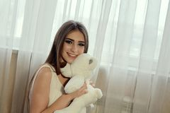 Girl with teddy bear for lifestyle design.Young caucasian model. Beautiful woman face. Girl with teddy bear for lifestyle design. Young caucasian model royalty free stock image