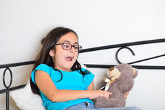 Girl with a teddy bear Royalty Free Stock Photo