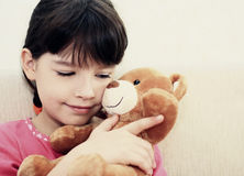 Girl with teddy bear. Royalty Free Stock Photography