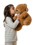 Girl with teddy bear. Little young girl holding teddy bear on white background stock images