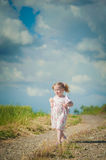 Girl with teddy bear on nature background, blue sky Stock Photos