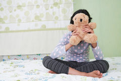 Girl with teddy bear Royalty Free Stock Images